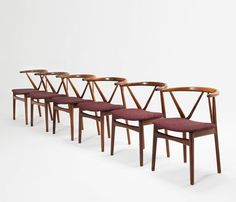 Set of Six Armchairs by Henning Kjaernulf in Rosewood | From a unique collection of antique and modern dining room chairs at https://www.1stdibs.com/furniture/seating/dining-room-chairs/