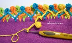 Manta bebé con borde de pompones a #crochet!