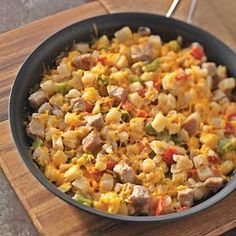 Hash Brown Pork Skillet Recipe -Our Test Kitchen adds potatoes and veggies to leftover pork tenderloin for an easy, creamy weeknight supper in minutes! Simple & Delicious Test Kitchen