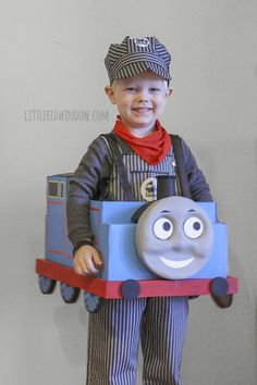 Tutorial for an adorable Thomas the Train Halloween Costume made from a cardboard box from Little Red Window!
