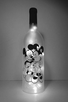 Mickey and Minnie Lighted wine bottle sealed. by WicksandWine Mickey and Minnie Lighted wine bottle sealed. by WicksandWine Glass Bottle Crafts, Wine Bottle Art, Painted Wine Bottles, Lighted Wine Bottles, Diy Bottle, Painted Wine Glasses, Bottle Lights, Decorate Wine Bottles, Wine Craft