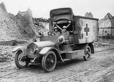 The two 'Women of Pervyse', Mairi Chisholm and the Baroness de T'Serclaes driving their motor ambulance through the ruins of Pervyse., Brook...