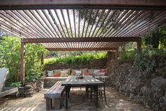 """""""We like having friends over for casual meals and BBQs, so we built an outdoor 'room' with a big sofa lounge area and long table under a shade structure. Ojai's weather is pretty great, so we use that space nine out of twelve months."""""""