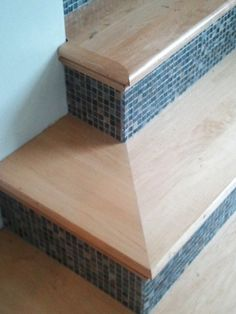 Add interest to your staircase using glass tile on the risers. Mix it up - stairs don't have to be all one finish. Mixed Pacific Blue Glimmer Glass tile