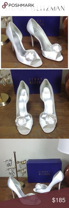 NWT Stuart Weitzman White Satin Open Toe Heels 100% authentic new with tags Stuart Weitzman beautiful white satin half d'orsay heels with open toe and oversized satin rosette.  Leather lined stilettos that are elegant and timeless.  In excellent new condition with a small mark (see pic).  Comes with original box that was slightly damaged during a move.  Thanks for your interest!  Please checkout the rest of my closet. Stuart Weitzman Shoes Heels