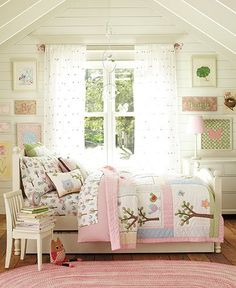Pretty bedroom~A gorgeous bedspread - and look at those pretty curtains! This is a beautiful room for a little girl that will be appropriate for anywhere from 3-12 years old. It's got enough pink for a little princess, but the design is not too babyish and preteens should love it as well.