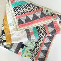 This modern baby quilt would be a great addition to any boho baby nursery, or even a throw quilt for your own space!  High quality quilting cottons