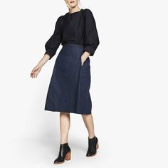 This refined-yet-relaxed A-line skirt is rendered in luxurious dark-wash denim, so it's polished enough for theoffice. Best of all, there are secret pockets