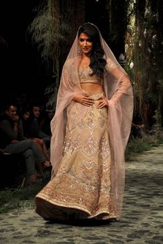 Chitrangada Singh in an ivory-coloured Tarun Tahiliani Couture leheng. Photo by IANS