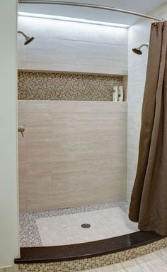 The master bath shower has two showerheads, and a long horizontal niche for plenty storage