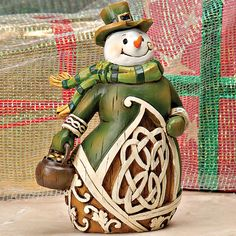 """Celtic Snowman    This snowman with his happy face, top hat and Celtic shamrock design will add joy to your Christmas season. 6"""" tall. Wood."""