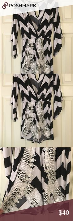 Black and white chevron romper! Brand new black and white chevron romper. New without tags, bought at boutique and never wore! Adorable with lace details on front and keyhole in back. Perfect for a summer night date! Size medium Pants Jumpsuits & Rompers