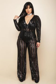A plus size jumpsuit with a scooped neckline and long sleeves. Features straight-legged pants. Sheer mesh contrast sequin stripes all over.