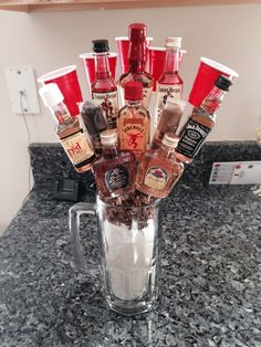 Man bouquet! Made this for my boyfriends 21st birthday! Different mini bottles of liquor, cigars, and mini solo shot cups!