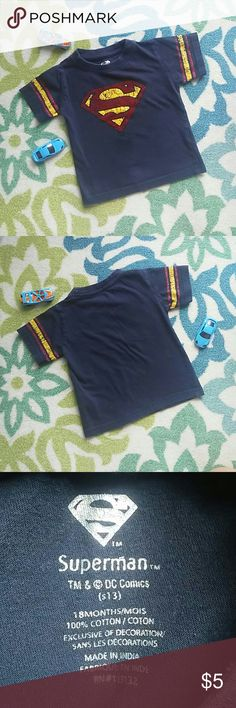 Superman Infant Tee 18 Months Adorable Superman tee for your little super man. Featuring the Superman logo on front with red and gold varsity stripes on each sleeve. Size 18M. Excellent Pre-loved Condition. Fast Next Day Shipping. Thank You for Shopping my Closet. Shirts & Tops