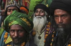 Indian Muslim Sufi devotees stand during a procession to the revered Muslim Shrine of Ajmer Sharif during the Urs Festival in Ajmer, Rajasthan, Monday, May 21, 2012. AP / Kevin Frayer