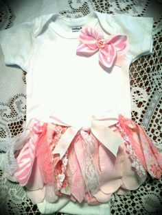 A little baby tutu and embellished onesie. I think i could do this!! Super adorable.