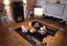conversation pit... love how it is dual purpose with the mega screen in the background......