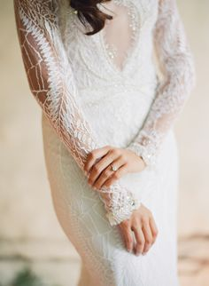 Low cut long sleeve lace wedding dress: http://www.stylemepretty.com/2016/05/18/a-modern-masculine-take-on-a-traditional-mexican-wedding/ | Photography: Jose Villa - http://josevilla.com/