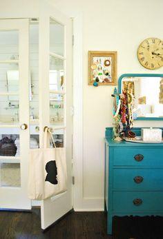 Wall color is BM Navajo White Dresser is painted BM deep sea green semi-gloss