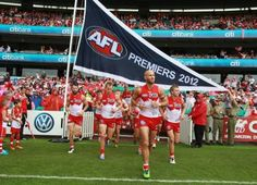 Ted Richards games) leads the Sydney Swans out after the unfurling of the premiership flag Australian Football League, Moore Park, Sydney Australia, Rugby, Melbourne, Sporty, Club, Ted Richards, Swans
