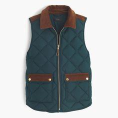 "Our customer-favorite down vest that's slim and lightweight, but still warm enough to keep chilly weather at bay—now in new, perfect-for-fall colors with cozy corduroy details, which we're kind of obsessed with this season. <ul><li>Cut for a boxy fit.</li><li>Body length: 24 1/2"".</li><li>Hits at hip.</li><li>Down-filled poly.</li><li>Standing collar.</li><li>Zip closure.</li><li>Pockets.</li><li>Machine wash.</li><li>Import.</li><li>Online only.</li></ul>"