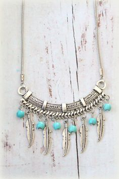 native inspired dangle silver Feathers and Howlite Turquoise beads necklace Bohemian Southwestern Tribal Statement piece designed by Inali