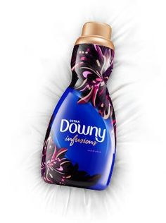 Downy® Infusions™ Orchid Allure Liquid fabric softener adds a touch of intriguing softness to your fabrics, all while whispering to your senses with hints of soft pomegranate and rich musk.