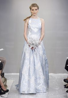 Theia's bridal dress with a turtleneck for the winter wedding. Embroidered hand-woven tweed coat with a duchess satin shawl collar. Sheath dress with a crystal