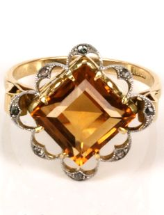 Art Deco citrine and diamond ring.   Hand made in 18ct yellow gold and platinum, this Art Deco era ring is set with a gorgeous 3.70 carat citrine that has such a perfect golden colour to it and matches so well with the gold and platinum.