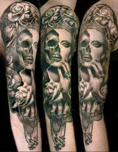 Skull face sleeve tattoo