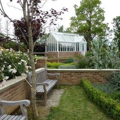 An unusual bespoke Hartley Botanic Villa greenhouse with an offset porch #Hartley #HartleyBotanic #Greenhouse #Glasshouse #Bespoke