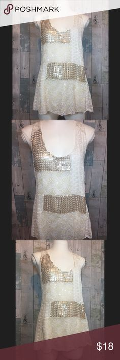 Carmela Patchwork Tank Top by TINY Excellent condition! Top is 26 inches in length. Armpit to armpit is 18 inches. Self is 100% rayon. Smoke free and pet free home. Anthropologie Tops Tank Tops