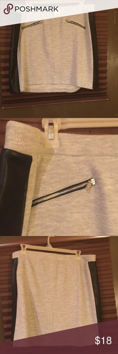 """Mini skirt with faux leather side strips & zippers This is a cute skirt that is along the lines of a sweatsuit material with faux leather strips on each side. Stretchy and comfy! The zipper decorations on the front give it an edgy look. Elasticized waist. Wear over leggings and you've got a really cute outfit going on! 3 sizes to choose from! 18/20-18"""" length, 24"""" hip to hip; 22/24-18"""" length, 25"""" hip to hip; 26/28-19"""" length, 28"""" hip to hip. Cato Skirts Mini"""
