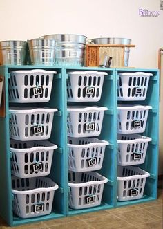 """Here you have 3 individual wooden boxes built to fit the width and length of a laundry basket. Approximately 22 inches wide, 25 to 27 inches deep and 4 ½ to 5 feet tall. Using 1"""" x 2"""" runners for the baskets to slid on.  If you wanted to build multiple stacks like in this picture as a connected unit you could eliminate one of the side panels, double the length of the top piece and just add runners on both sides of the side wall between the columns. Hope this helps. Happy organizing!"""