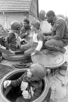 Members of the US Army Military Intelligence Company take time to show an armored personnel carrier to some West German youths during Exercise REFORGER Armoured Personnel Carrier, Cold War, Us Army, Frankfurt, Warriors, Tanks, Countries, Youth, Germany