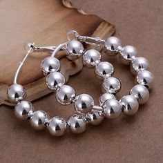 925 Sterling silver plated round beads earrings Condition : 100% brand new, round bead shaped hoop earrings Metal: 925 Sterling silver plated with 925 metal stamp Material: tin alloy, lead and nickel complaint  Size : 1.6 inch diameter Jewelry Earrings