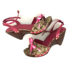 Coach Betsey jacquard wedge Strappy sandals NWOT Only tried on in the store! SO has slight wear to bottoms, and it's slight! Pink and brown classic Jaquared c print. Not a full wedge has a small cut out on the base. Almost a chunky heel.scuffs and scratches to the wood that makes up the wedge/heel •3.75 inches high     •no trades•no offsite transactions•no low balls•offers considered through the offer feature only!• OOZ Coach Shoes Sandals