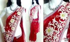 Red embroidered net saree CODE: SD088 PRICE: Rs.3620 SAREE: Red net saree with white floral embroidery having silver sequence, leaf motifs and silver lace border on the edges BLOUSE: Silver sequence material