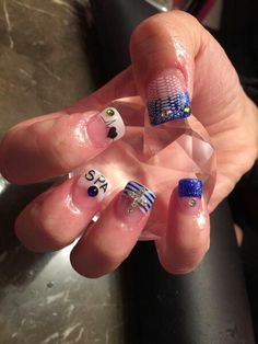 New nails. . 3-2-15 My heart beats for you,  SPA =my boyfriend's initials,  cross is for personal emotions, the rest is just style