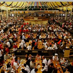 Attend Octoberfest. Munich, Germany. This is one of MANY beer tents. Each large brewer has their own tent where their beer is served exclusively. Get a giant pretzel and share some smoked fish with others at your table as we did. Had a blast!