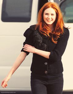 Karen Gillan's rolling up her sleeves. This is Scottish for someone's going to get punched.