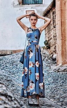 This vacation style dress is surely one that you'll love wearing over and over. It's easy-to-style, making it perfect for summer. This maxi dress with halter design and random floral print pattern.