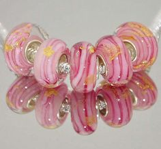A personal favorite from my Etsy shop https://www.etsy.com/listing/221272362/pink-glass-bead-silver-murano-lampwork