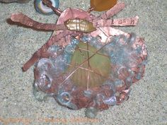 """"""" Make a Splash""""- form folded copper clam shell and cultured sea glass necklace - a ZnetShows design team challenge"""