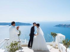 First kiss as husband and wife! From the intimate Santorini Wedding of Leong and Jean Santorini Wedding, Wedding Pins, First Kiss, Real Weddings, Husband, Wedding Dresses, Inspiration, Fashion, Bride Dresses