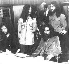 """George Harrison with Lon and Derrek Van Eaton. Klaus Voorman is at far left and Joey Molland is behind Derrek chatting with someone. Geoff Emerick's hand is visible at just to the right of George. This picture is from the opening party for Apple Studios and was used as a promotional image for Lon and Derrek's """"Brother"""" album. (Picture courtesy of Lon, Derrek and Constance Van Eaton.)"""