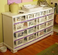 an old dresser without the drawers or a bookcase with baskets. Would look great with wicker baskets.