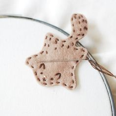 Keep your needle secure during a stitching break with this sweet flying squirrel needle minder!