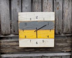 This rustic style clock is made to resemble pallet wood. Painted in colors of cream, yellow, and grey. It has been distressed to give it the perfect weathered charm. Black numbers and classic straight